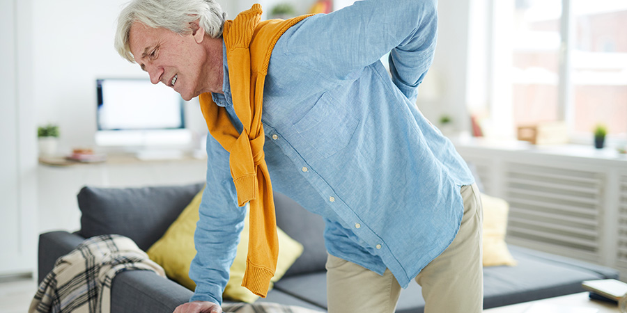 Mature man with back pain. Is CBD good for back pain?